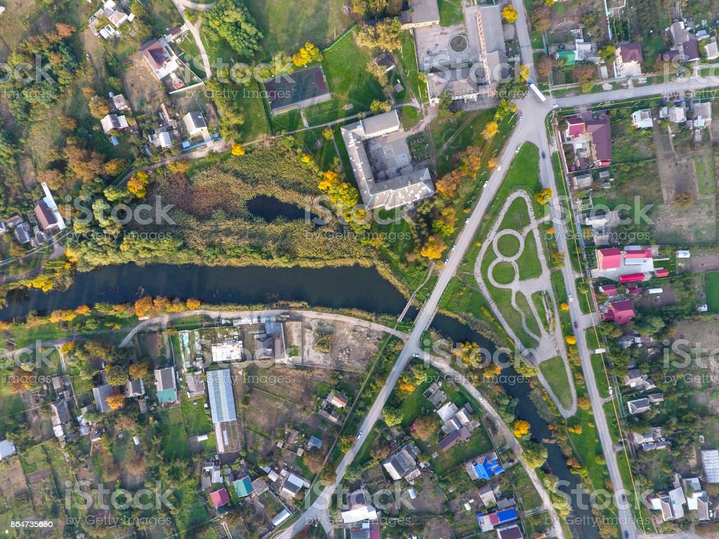 Top view of the village. One can see the roofs of the houses and gardens. Road and water in the village. Village bird's-eye view stock photo