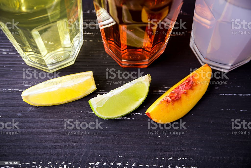 Top view of three slices of fruits and coctails stock photo