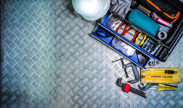Top view of tools box and helmet on checkered plate background in workshop. Service tools set. Home building and electrical tools. Plumber hand tools. Technician equipment for repair work. Top view of tools box and helmet on checkered plate background in workshop. Service tools set. Home building and electrical tools. Plumber hand tools. Technician equipment for repair work. adjustable wrench stock pictures, royalty-free photos & images