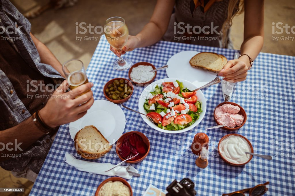 Top view of tourists toasting with drinks at Greek restaurant royalty-free stock photo