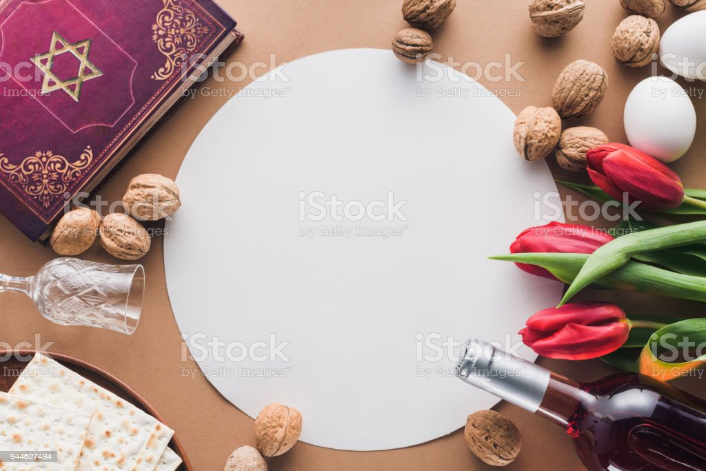 top view of traditional book with text in hebrew and blank placard on table stock photo