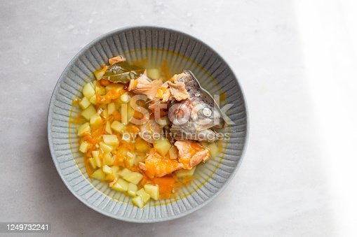 Top view of traditional Finnish soup with salmon, carrot  and potatoes