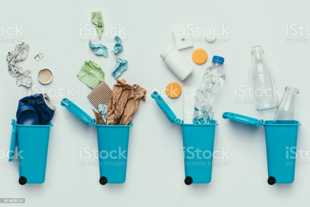 top view of trash bins and assorted garbage isolated on grey, recycle concept stock photo