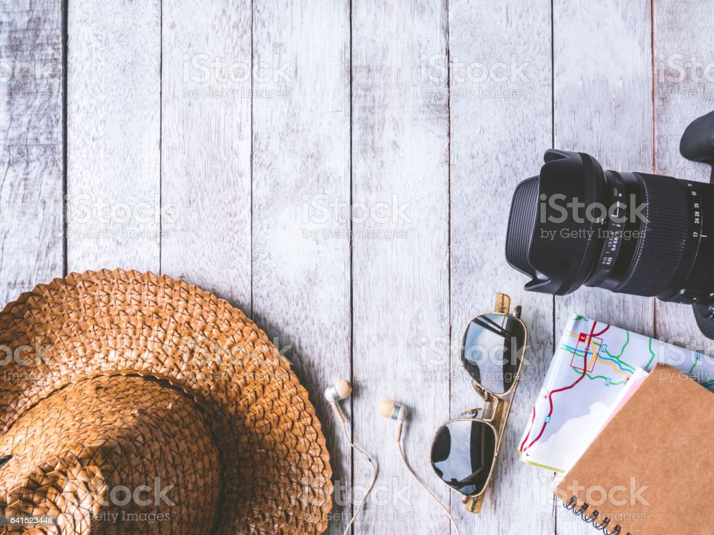 Top view of Travel accessories and costume on wooden table. stock photo