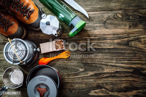 istock Top view of travel equipment and accessories for mountain hiking trip on wood floor making a frame with copy space 1149239411
