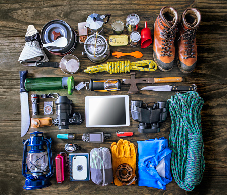 istock Top view of travel equipment and accessories for mountain hiking trip on wood floor 924375236