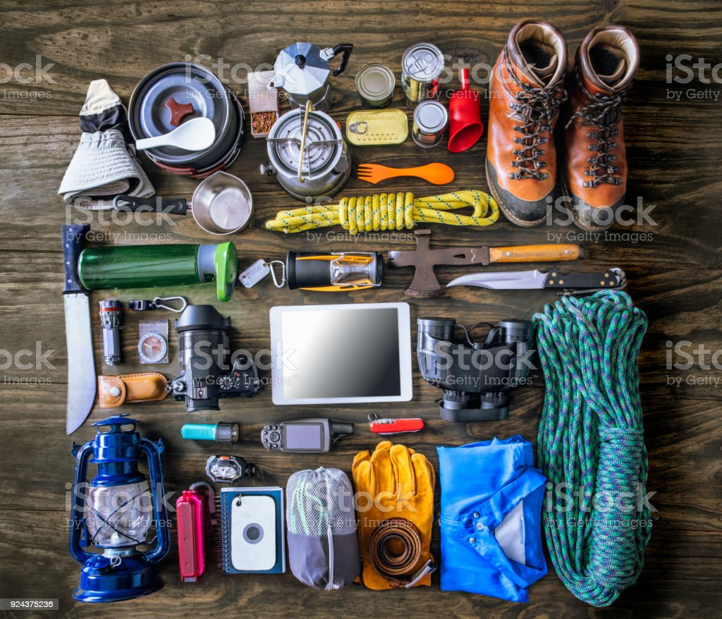 Top view of travel equipment and accessories for mountain hiking trip on wood floor stock photo
