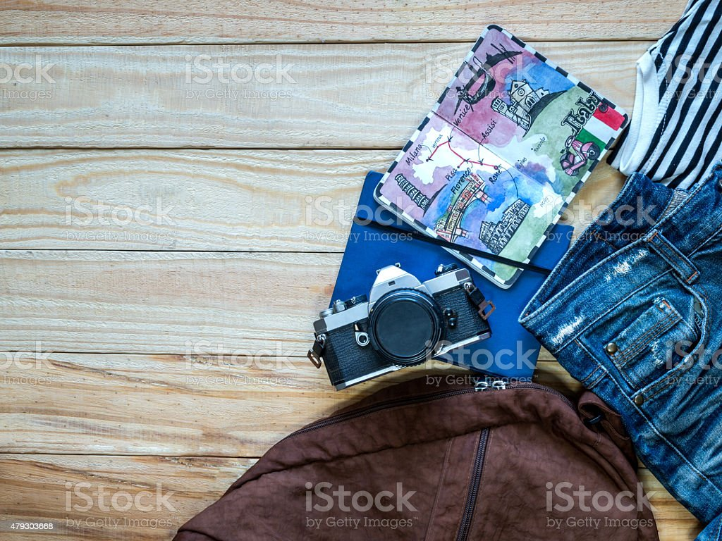 Top view of travel items on wooden background/ traveling concept stock photo