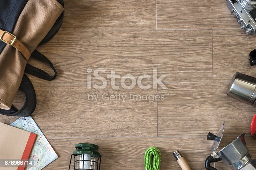 istock Top View of Travel Stuff on Wood Background, Camping and Coffee 676966714