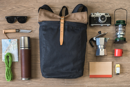 istock Top View of Travel Stuff on Wood Background, Camping and Coffee 676966770