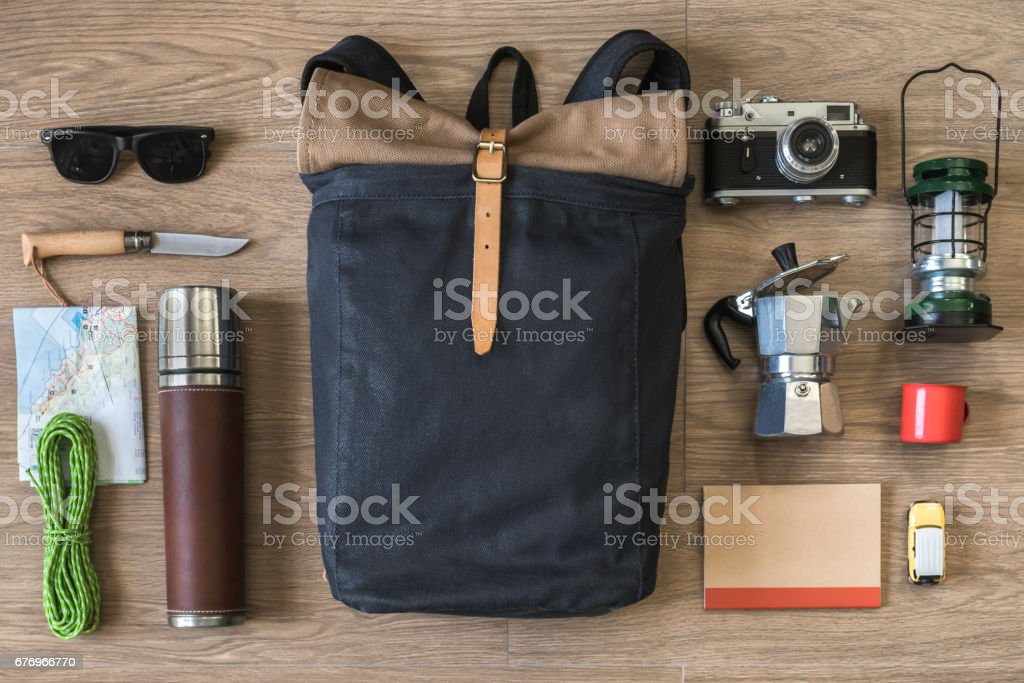 Top View of Travel Stuff on Wood Background, Camping and Coffee stock photo