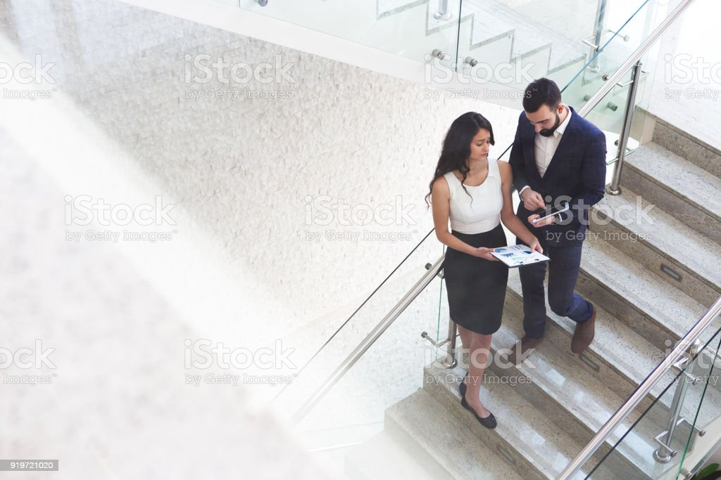 Top view of two business colleagues that talk about work outside office. stock photo
