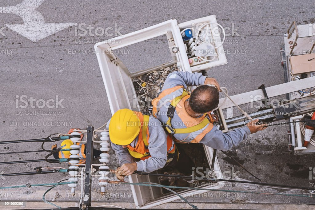 Top view of two electricians worker working in the cradle stock photo