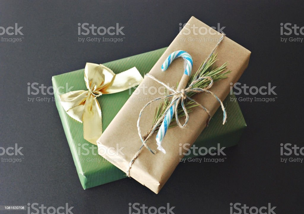 Top view of two gift present wrapped in festive wrapping paper for...