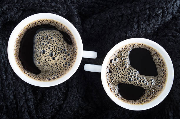 top view of two small cups of coffee - se déplacer vers le bas photos et images de collection