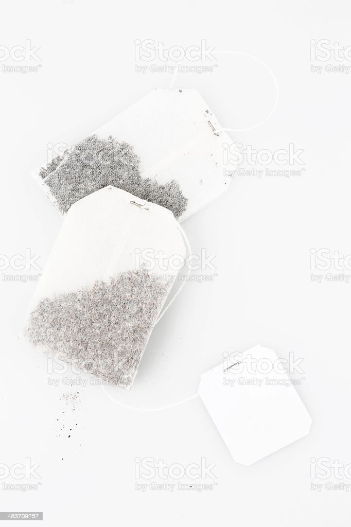 Top view of two tea bags on white stock photo