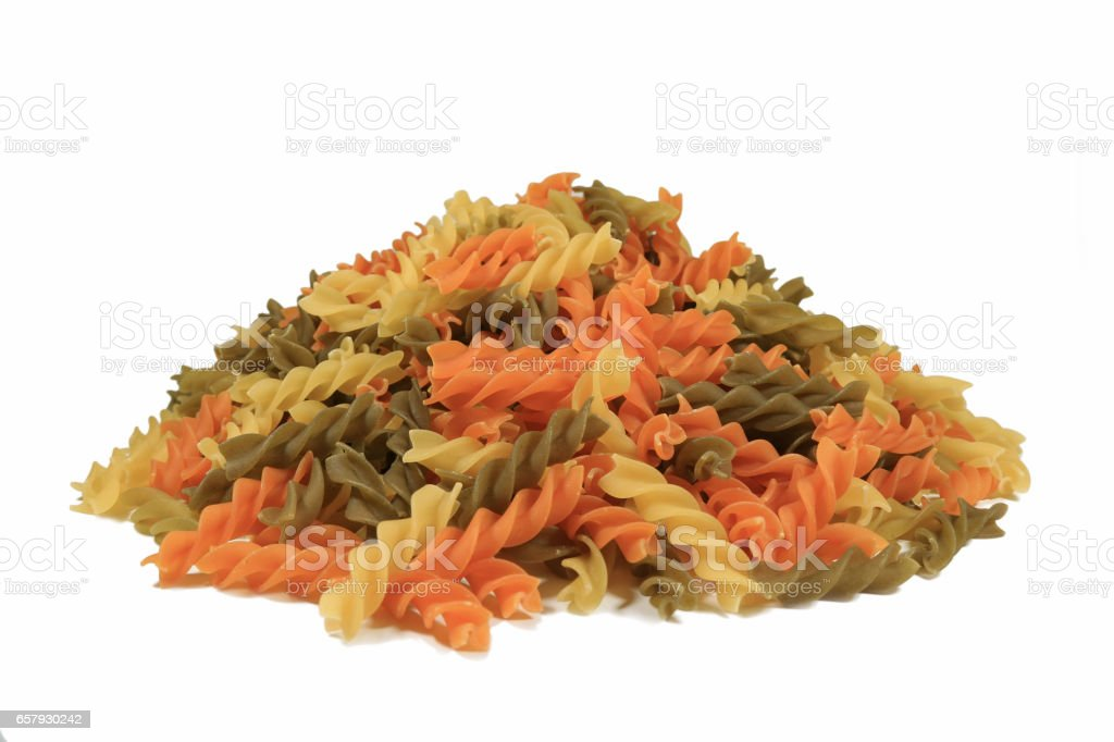 Top View of Uncooked Tricolor Fusilli, Three-Color Spiral Shaped Pasta stock photo