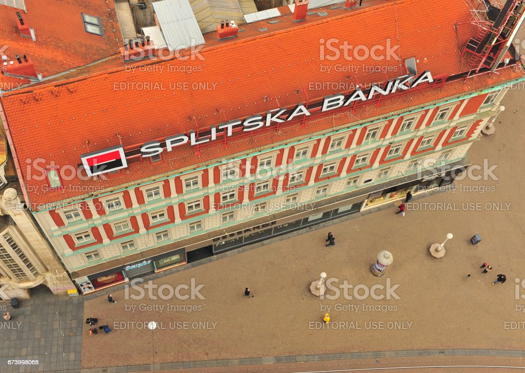 Top view of undefined people going near the bank office in Zagreb stock photo