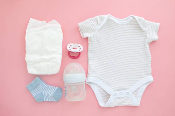 Top view of unisex newborn baby necessities stock photo