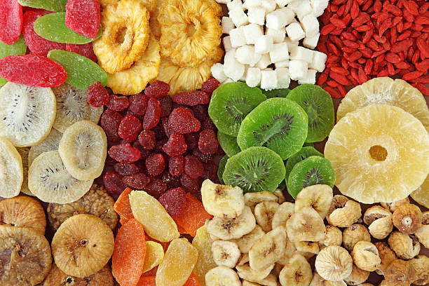 top view of variety of dried fruits - dried fruit stock photos and pictures
