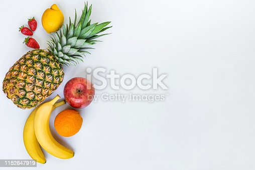 istock Top view of various fruits on a white background. Copy space. 1152647919
