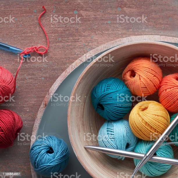 Top view of various yarn balls and latch hook on textured background picture id1166884851?b=1&k=6&m=1166884851&s=612x612&h=vykapko3ajxafjsa9 gpxbzpxh800wufraguig0edjw=