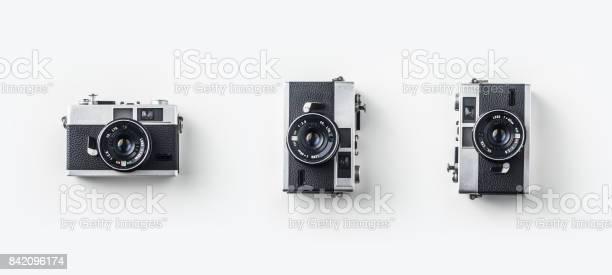 Top view of vintage cameras on white background desk for mockup picture id842096174?b=1&k=6&m=842096174&s=612x612&h=m2ivlc1r1ob112ggxzr6f9ami4c2 ckz9uehvz8nq4s=