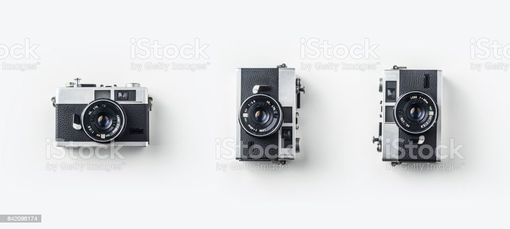 Top view of vintage cameras on white background desk for mockup – zdjęcie