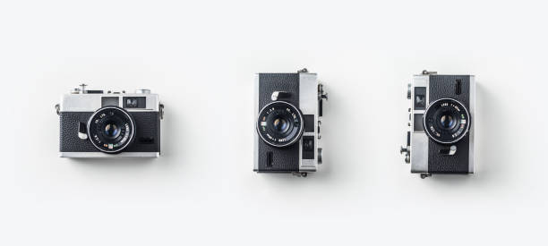 top view of vintage cameras on white background desk for mockup - camera photographic equipment stock photos and pictures
