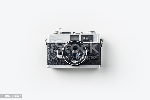 Top view of vintage cameras on white background desk for mockup