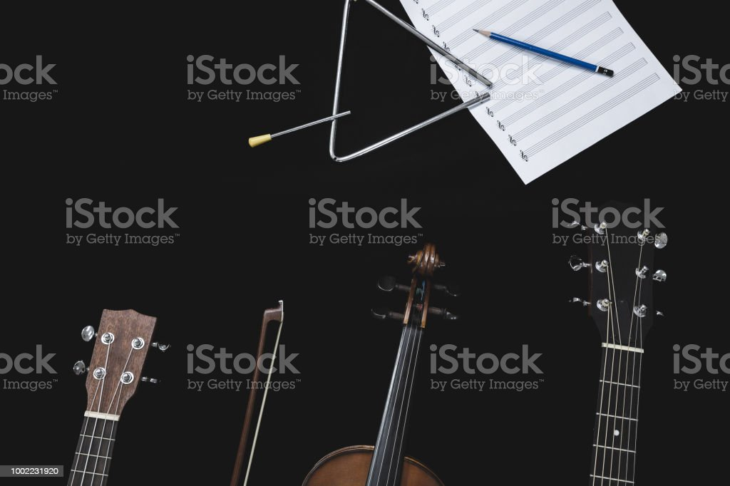 Top View Of Violin Guitar And Ukulele With Musical Note