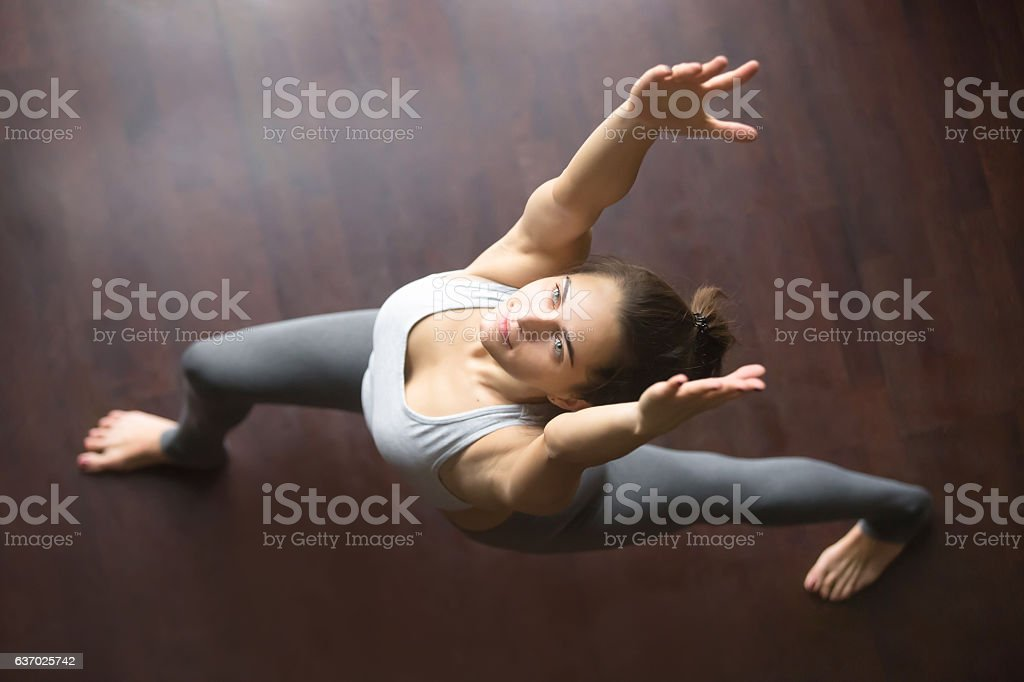 Top view of virabhadrasana 1 yoga Pose stock photo