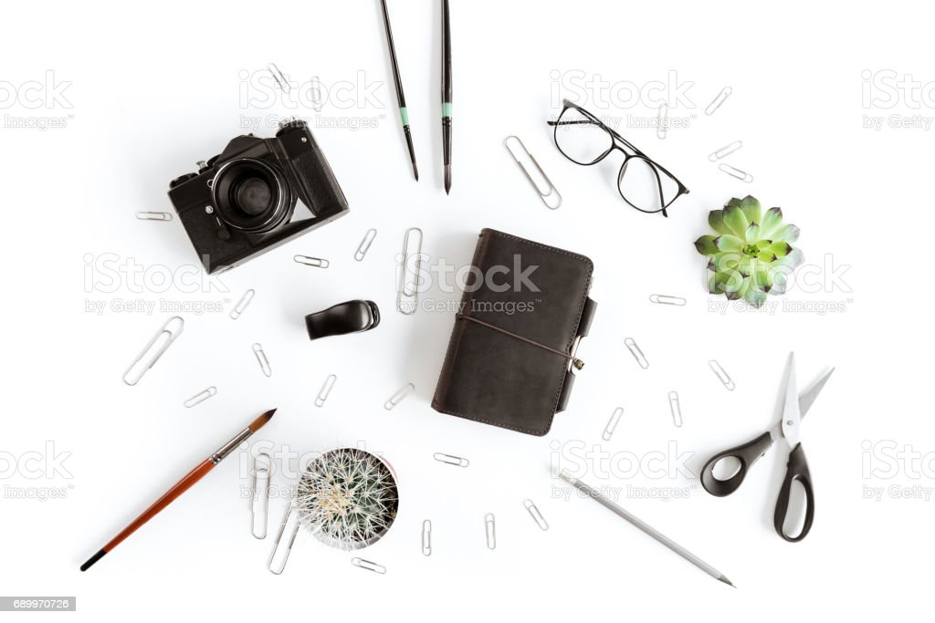 Top view of wallet, camera and various office supplies and plant isolated on white - fotografia de stock