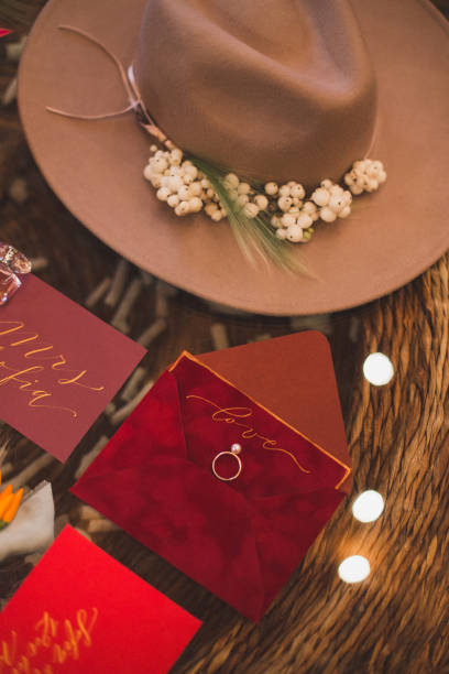 top view of wedding ring, invitations and hat in bohemian style stock photo