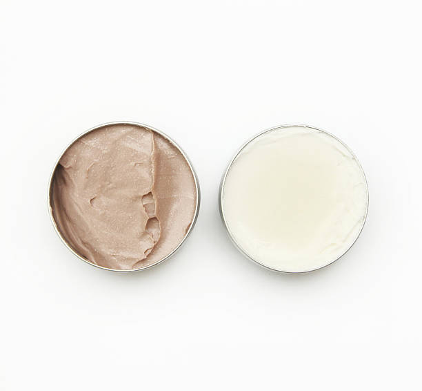 Top view of white and brown beauty creams Top view of white and brown beauty creams theobroma stock pictures, royalty-free photos & images
