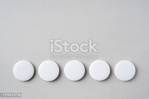 istock top view of white badge on grey background 1174111715