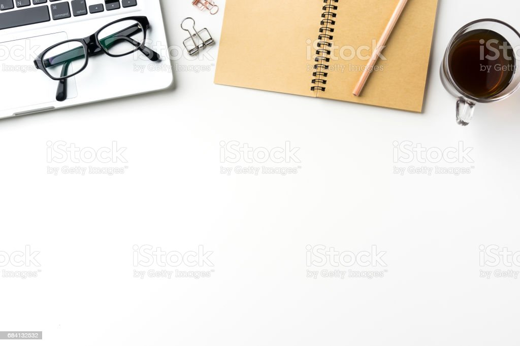 Top view of white desktop background with notebook, coffee, smart phone... foto stock royalty-free