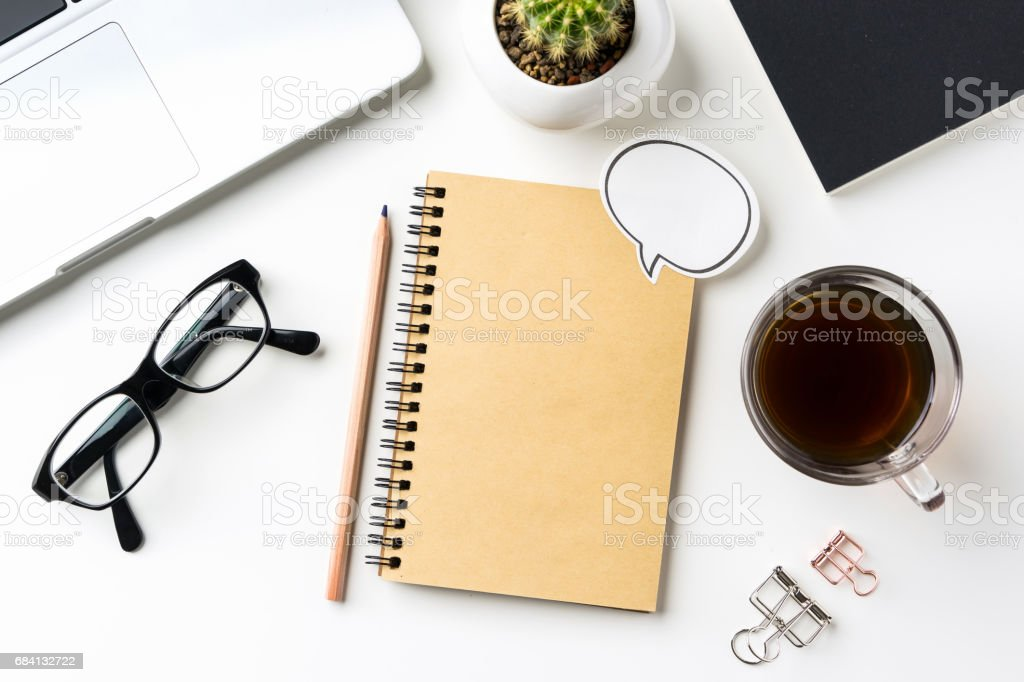 Top view of white desktop background with notebook, coffee, smart phone... royalty-free stock photo