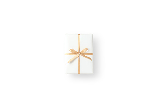 Top view of white gift box with gold ribbon on white isolated background with copy space. Christmas, Birthday and New year concept.