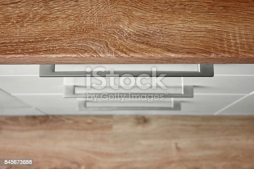 607472174 istock photo Top view of white kitchen cupboard 845673688