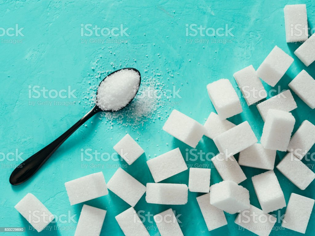 Top view of white sugar cubes on turquoise background royalty-free stock photo