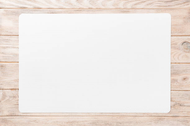 Top view of white table napkin on wooden background. Place mat with empty space for your design stock photo