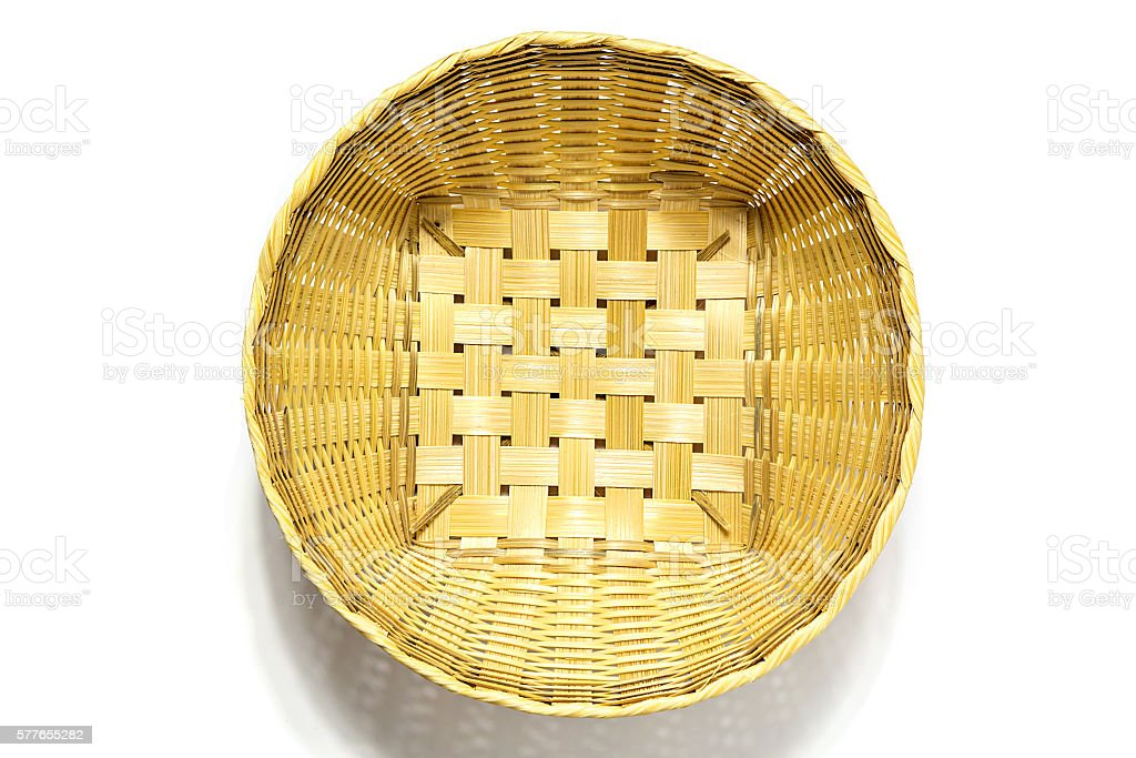 Top view of wicker basket isolated on white background stock photo