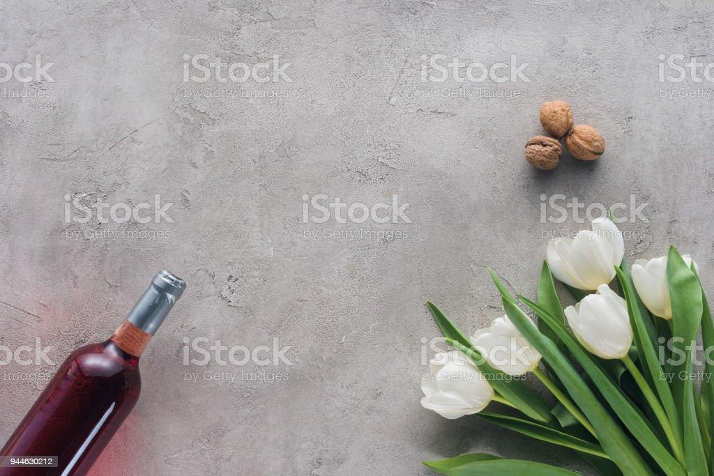 top view of wine and tulips on concrete table, jewish Passover holiday concept stock photo