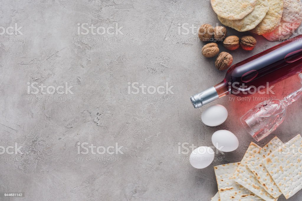 top view of wine, matza and chicken eggs on concrete surface, Pesah celebration concept stock photo