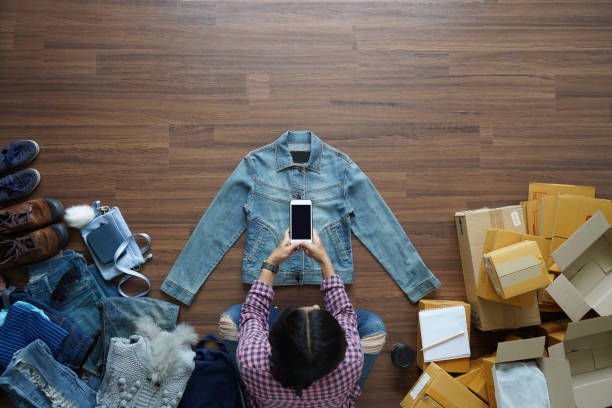 Top view of women take a photo jeans jecket with smart phone from on picture id954505686?b=1&k=6&m=954505686&s=612x612&w=0&h=hgq5bmkk57khs3ijlileywa v2wjzdlrx5uf6maobbw=