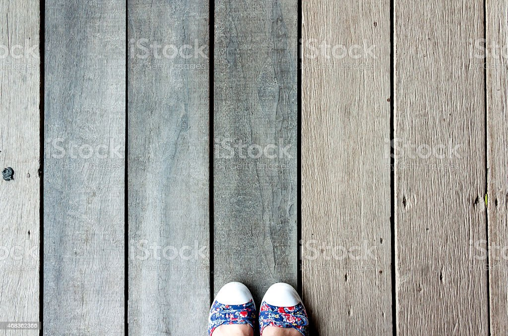 Top view of wood floor and human feet royalty-free stock photo
