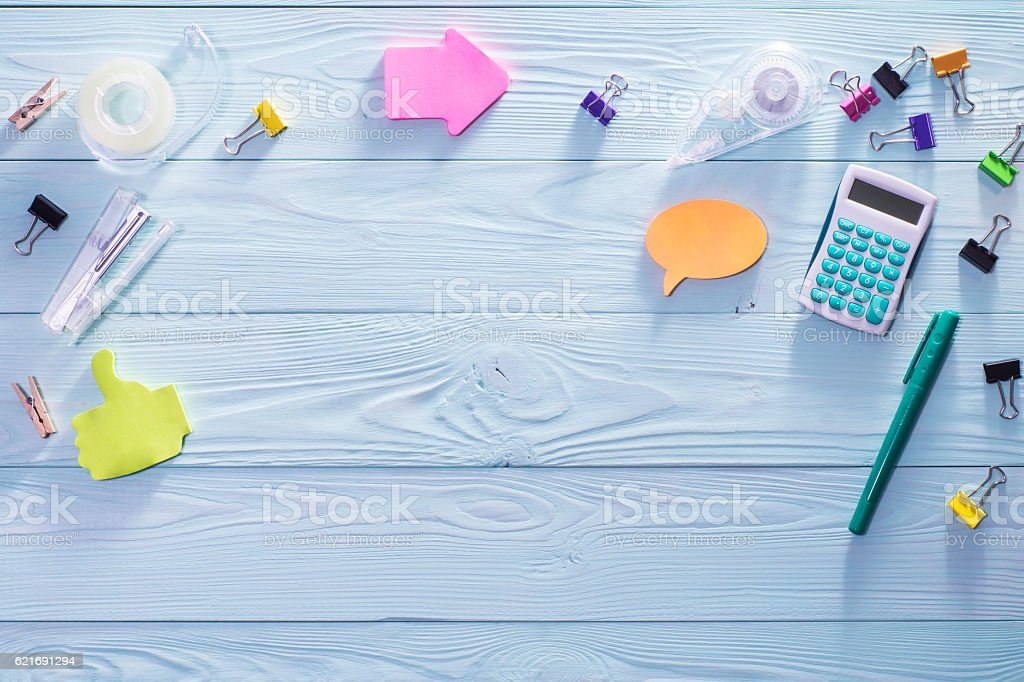 Top view of wooden desktop with bright colorful stationery items stock photo