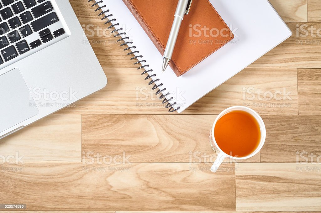 Top View of Wooden Office Table With Laptop and Others stock photo