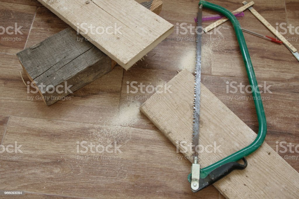 Top view of woodwork tool -saw, and wooden plank - Стоковые фото Албания роялти-фри